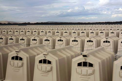 """""""This is not graphic or gory -- but no less deplorable. Apparently, this is in Oregon. Each crate has a calf in it, removed from their mother one hour after they were born. The mother had enough time to clean up the birth, lick, smell and intially bond with the calf, before they were taken away to live in boxes. Death will ensue in approximately six weeks. Until then, here they remain, unable to move, so as to make their meat 'tender.' Then they become veal steaks. Please everyone, for the sake of all -- go vegan"""" [www.earthlings.com]"""